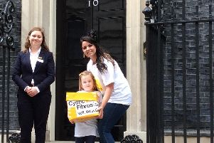 Gemma Weir and her four-year-old daughter Ivy, from Portsmouth, delivered hundreds of letters to Downing Street calling for drug Orkambi to be free. They are pictured with Grace Paget from the Cystic Fibrosis Trust