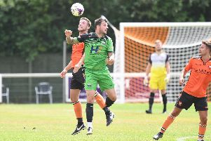 Craig McAllister, green, has his work cut out at Gosport Borough. Picture: Neil Marshall