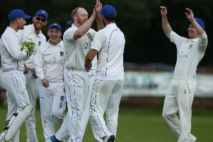 Allen Coulter CIYMS celebrating his wicket against Waringstown