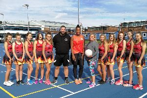 Eboni Beckford-Chambers, Helen Keet and personal trainer Rob Baldwin with members of the All About Netball League