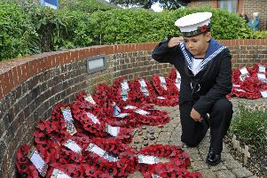 HMS Sultan RN Cadet Brodie Turner (10) pays his respects. Picture: Ian Hargreaves