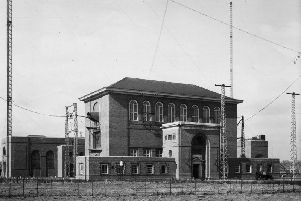 A historic image of the C Station building on the former radio mast site, now the Houlton urban extension.