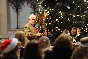 Michael Woolley at the 2016 St Mary's Church carol service, which marked the end of the Christmas voucher campaign for the year. Picture: Sarah Standing