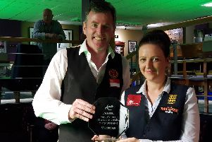 Emma Bonney picks up her trophy from World Billiards number one ranked player Peter Gilchrist