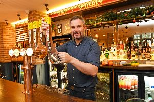 General manager Matt Chapman pulls a pint at the recently opened Brewhouse and Kitchen pub in Southsea. Picture: Malcolm Wells