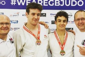 Rush Judo coaches Laurie Rush and Pete Brent with BJA national championship medallists Tom Lish and Michael Fryer.