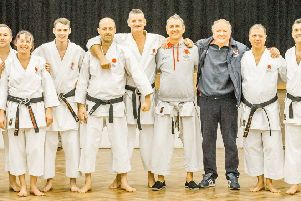 The successful SSKI Dan grade participants and the panel at Hemel Hempstead School at the weekend.