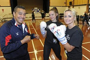 Q Shillingford, left, instructs Millie Lawrence and Malvina Price at the launch event for the new Heart of Hayling Boxing Club, in funded by the Lions. Picture: Ian Hargreaves