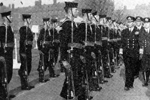George VI visiting Portsmouth Royal Naval Barracks during the Second World War.