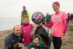 Ian, Freya, Sabrina and Evan at Lee-on-the-Solent parkrun. Ian and junior runner Freya joined the 50 parkrun milestone club. Picture: Keith Woodland (190119-192)