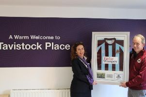Chair of Woburn and Wavendon FC, Robert Hill with the framed shirt at the Tavistock Place sales office