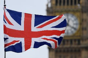 A Union flag flies near the Elizabeth Tower, commonly referred to as Big Ben, at the Houses of Parliament 700026947