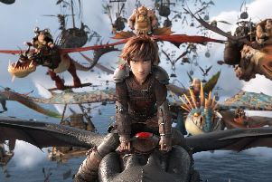 Hiccup rides Toothless into battle in How To Train Your Dragon: The Hidden World. Released February 1.