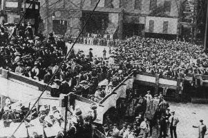 When Portsmouth Dockyard was the largest in the world we see workers and families at the launch of HMS Queen Elizabeth in 1913.