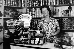 Pictured in her shop at 67, Toronto Road, Landport is Mrs Ethel Morse. Nestles Milk seemed to be popular. Photo: Tony Davis collection.