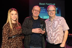 News reporter Millie Salkeld presents Peter Chegwyn and Graham Hiley of Wickham Festival with the trophy for Best Festival. Picture: Sarah Standing (280119-7368)