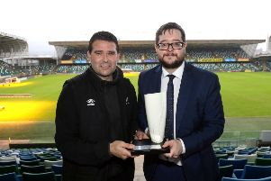 Linfield manager David Healy collects the Belleek trophy from NIFWA Chairman Keith Bailie