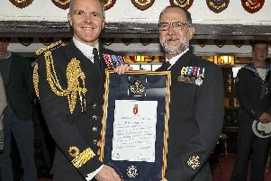 Pictured: Naval Base Commander, Commodore Jim Higham OBE ADC RN presenting Warrant Officer George Boardman RN with is Valediction after serving 42 years in the Royal Navy.''''ROYAL NAVAL WARRANT OFFICER RETIRES AFTER SERVING LONGER THAN LORD NELSON''''THE ROYAL Navys longest serving Weapon Engineer (WE) Rating, WO George Boardman, will be presented his Valedictory Certificate by the Royal Navys most Senior Naval Officer in the WE branch, Cdre Jim Higham, onboard the longest serving Royal Navy warship, HMS Victory.''''WO Boardman joined the Royal Navy in September 1976 as a Junior Engineering Mechanic, completing 42 years and 7 months service  thats more time than Lord Nelson.''''During his career he has fulfilled a myriad of roles across the Navy and notably in 2007 he was assigned to Iraq for Operation Telic as a Regimental Quarter Master Sergeant.