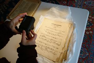 Pouring over Gunby Hall's musical heritage. Picture: National Trust