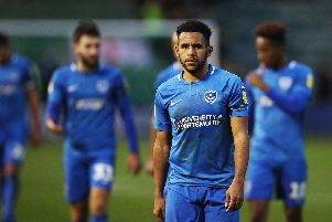 Nathan Thompson and his Pompey team-mates leave the pitch at Plymouth Picture: Joe Pepler