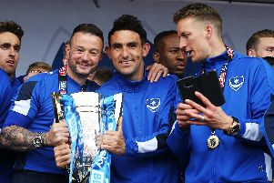 Noel Hunt, left, celebrates Pompey's League Two triumph with Gary Roberts, centre, and Carl Baker. Picture: Joe Pepler