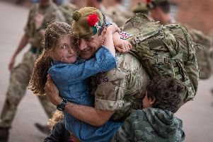 A soldier is welcomed back home after six months in Iraq. Photo: MoD