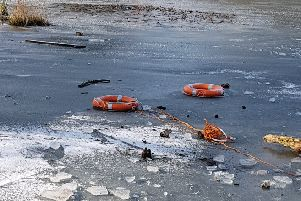 Life saving rubber rings were thrown onto the frozen pond. Picture: Jonathan Schofield. EMN-190402-152840001