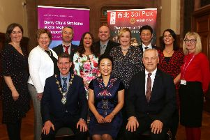 Pictured at the Chinese New Year celebrations hosted by the Mayor of Derry City and Strabane District, Councillor John Boyle, are back row from left Angela Askin DCSDC, Donna Blaney, the Executive Office, William CWA, Angela O'Kane, Mayoress, Kevin Curran, the Executive Office, Carol Stewart DCSDC, Tommy Yeung, Sai Pak, Pauline O'Neill DCSDC and Amanda Biega DCSDC.  In the Front Row are Mayor Boyle, Chinese Consul Madame Zhang, and Council Chief Executive John Kelpie.