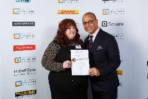 Beckie Wood from What's The Debate? recieving an award from Theo Paphitis