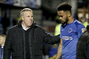 Kenny Jackett consoles Anton Walkes following last night's disappointing 1-1 draw with Bristol Rovers. Picture: Robin Jones/Digital South