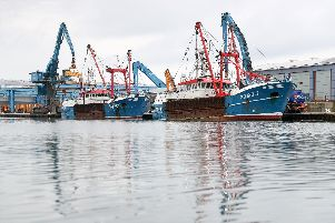 The Honeybourne 3 (right), a Scottish scallop dredger, in dock at Shoreham, West Sussex, following clashes with French fishermen in the English Channel in August during a long-running dispute over the scallop-rich area that the French are prevented from harvesting.The vessels are pictured damaged and battered following the clashes. Photo: Andrew Matthews/PA Wire