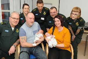 All the paramedic team that helped on the day, Ray Connearn, Deneka O'Brien, Gilbert Hall, James Grant and Kellie Blake with the twin's parents, Mark Lawrence and Nikki Fletcher with the twins, Oliver and George''Picture: Habibur Rahman'.