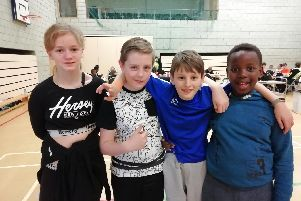 From left, Demi Jones (10), Leon White (11), Samuel Barker (10) and Elijah Sengu (9)