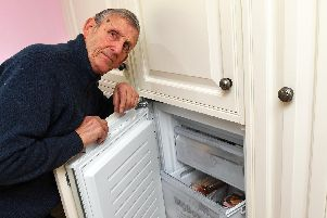 Mike Lilly, with the 'freezer' area of the two integrated units that eventually had to be completely replaced'Picture: Malcolm Wells (190220-3928)