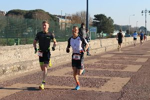 Rob Arkell (left) and Neil Collins competing for the victory. Portsmouth Duathlon Series race one. Picture: David Brawn