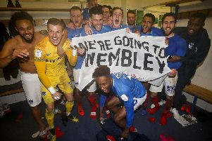 Portsmouth celebrate in the changing room after winning the Checkatrade Trophy Semi Final match between Bury and Portsmouth at Gigg Lane on February 26th 2019 in Bury, England. (Photo by Daniel Chesterton/phcimages.com)