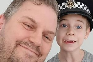 PC Mike Harvey with seven-year-old James Glass after helping him overcome his fear of police. Picture: Family handout/Sussex Police/PA Wire