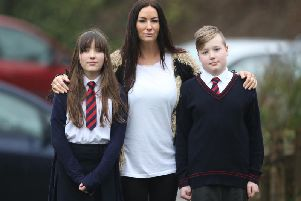 Jacqueline Brookes with her children Tiggy (left) and Leon, both 10. Pic: Eddie Mitchell