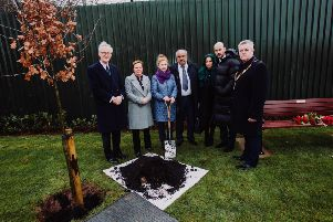 Mrs Azimkar and family are joined by Mr Mark Campbell, Randox; Chief Executive of Antrim and Newtownabbey, Mrs Dixon and Mayor of Antrim and Newtownabbey, Cllr Paul Michael at the private memorial service held earlier this morning where a commemorative tree was planted and bench was unveiled.