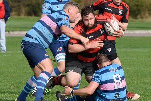 Harrison Fokinther, centre, will move from loose-head prop to blindside flanker for Fareham Heathens. Picture: Duncan Shepherd