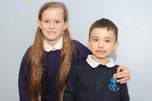 Head girl, Ella-May Muscat, 11, and Kaydyn Walker, five, who uses Makaton to help him with his speech.'Picture: Habibur Rahman