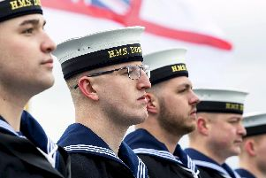 Sailors from HMS Duncan line the upperdeck for Procedure Alpha as the type 45 destroyer sets sail from Portsmouth. Photo: LPhot Ben Corbett