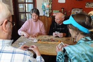 League members Jane Turner and Len Palmer play a game of crib. Picture: Sarah Standing (260219-282)