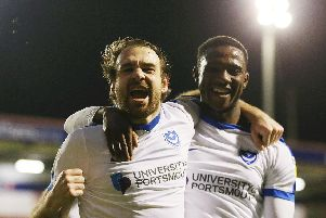 Brett Pitman celebrates his goal that set Pompey on the way to victory