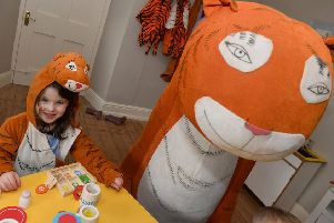 Four year-old Amelia Jones enjoying The Tiger who came to Tea event at Gunby Hall.