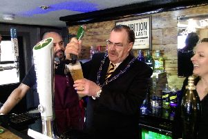 The Mayor of Louth, Councillor George Horton, pulls the first pint.