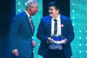 The Prince of Wales with winner of the Educational Award Jay Kelly on stage at the annual Prince's Trust Awards at the London Palladium.  Picture: Dominic Lipinski/PA Wire