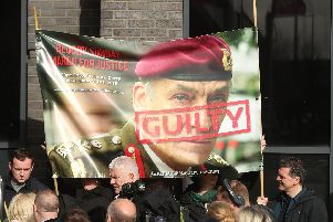 Supporters hold a poster of General Sir Michael David Jackson outside the city hotel  Londonderry, Northern Ireland ahead of the announcement as to whether 17 former British soldiers and two former members of the Official IRA will be prosecuted in connection with the events of Bloody Sunday in the city in January 1972. Picture: Niall Carson/PA Wire