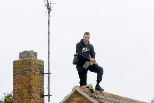 Liam Warrener pictured in the rooftop standoff in October last year near Asda in Portsmouth. Picture: Habibur Rahman