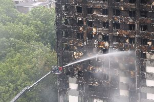 Water being sprayed on Grenfell Tower after the fire at the tower block Picture: Rick Findler/PA Wire